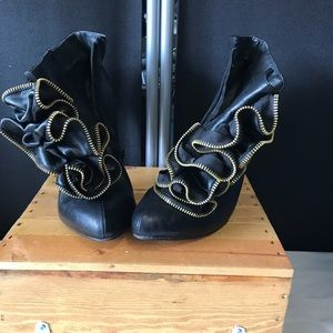 Size 11 booties with a zipper ruffle